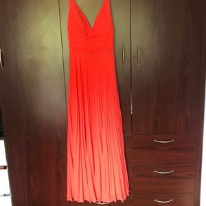 Coral open back pleated dress